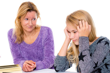 blond girl has problems with the homework Stock Photo
