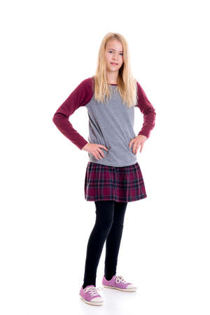 portrait of a nice blond girl in plaid skirt