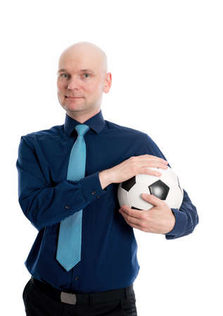 portrait of a young businessman with soccer ball in front of white background