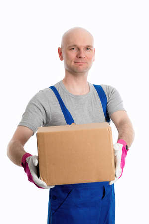skinhead: young man in flap trousers with cardboard in front of white background