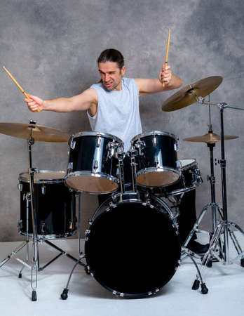 bass drum: young musician with his black drum set Stock Photo