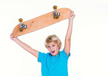 jubilating: happy boy in blue dress with skateboard Stock Photo