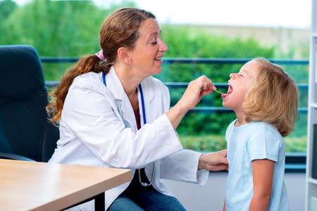pediatrist: female pediatrician in white lab coat examined little girl