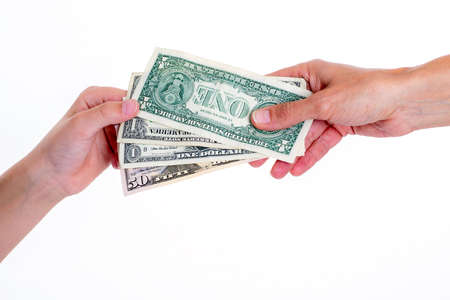 two hands with money in front of white background Stock Photo