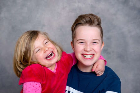 bonny: brother and sister together in front of gray background