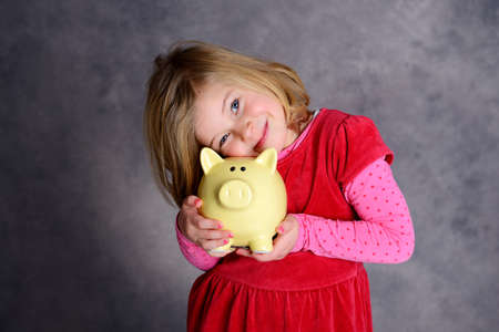 portrait of a smiling girl with piggy bank Stock Photo