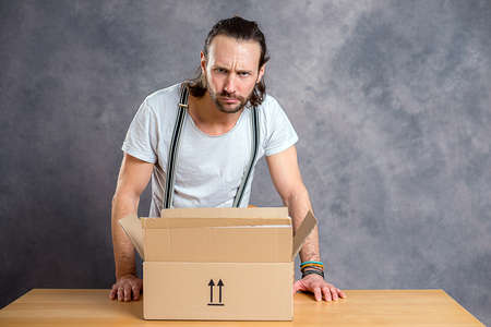 unsatisfied: young man is discontent with his delivery