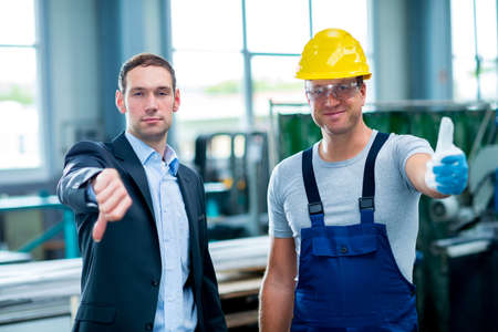 collective: collective bargaining- boss with thumb down and worker with thumbs up and down Stock Photo