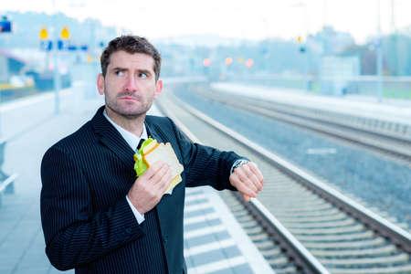 break fast: businessman on trip has a fast break