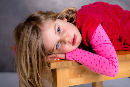 whine: littlegirl is in bad mood and looking sad Stock Photo