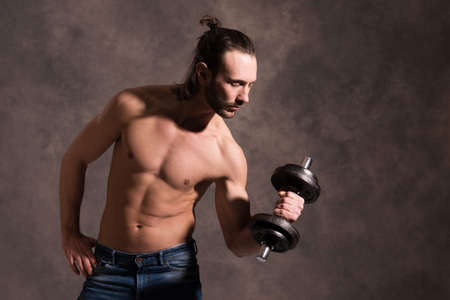 fitnesscenter: young white man exercised body train with bar-bell
