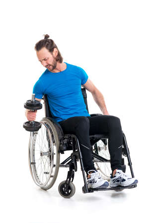 fitnesscenter: young disabled man in wheelchair train with bar-bell