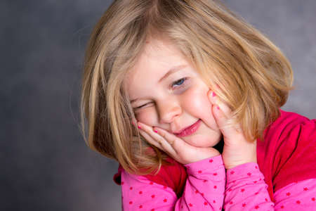 bad temper: little girl is in bad mood and crying