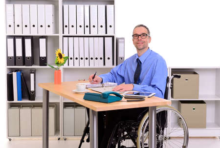 paraplegico: disablet business man in wheelchair is looking in to the camera