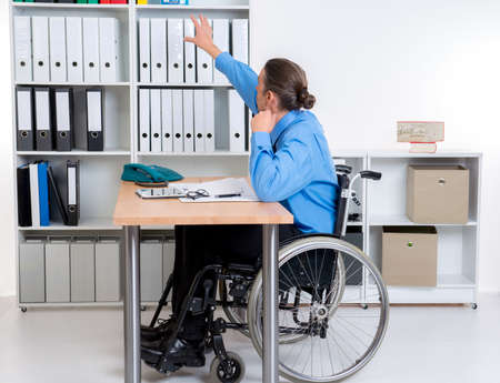 need help: disabled business man in wheelchair need help