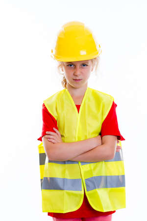 reflective vest: blond girl with reflective vest and helmet in front of white background Stock Photo