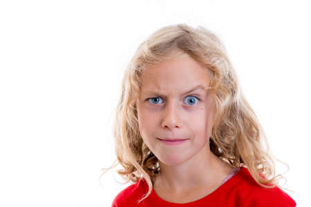 skeptical: nice blond girl looking skeptical with eyebrow up Stock Photo