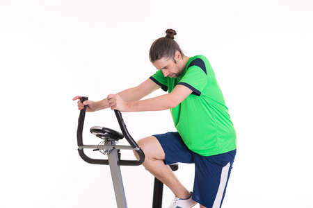 distension: young man warming up for train with fitness machine