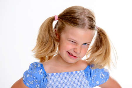 bold: portrait of a little bold girl with pigtails Stock Photo