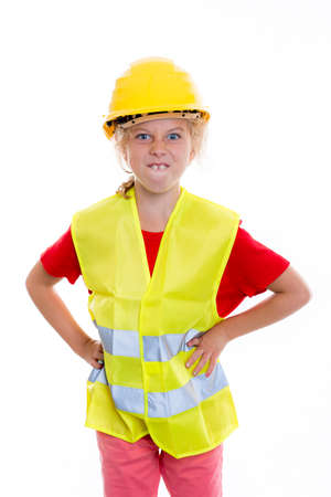 reflective: blond girl with reflective vest and helmet in front of white background Stock Photo