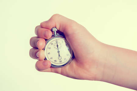 hand with stopp watch in front of white background