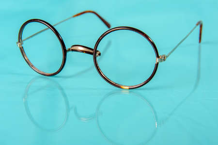 reflective: old round glasses on blue reflective ground