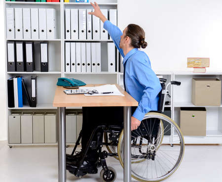 need: disabled business man in wheelchair need help