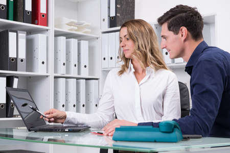 young businessman and businesswoman working together in the office