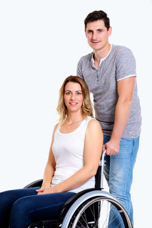 paraplegico: young beautiful disabled woman in wheelchair and her husband