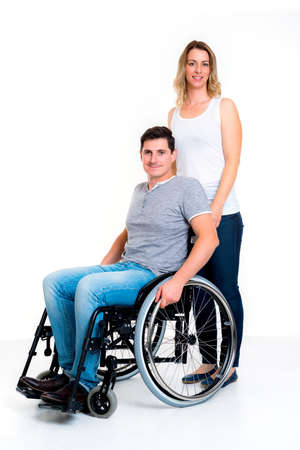paraplegico: young disabled man in wheelchair and his wife Foto de archivo