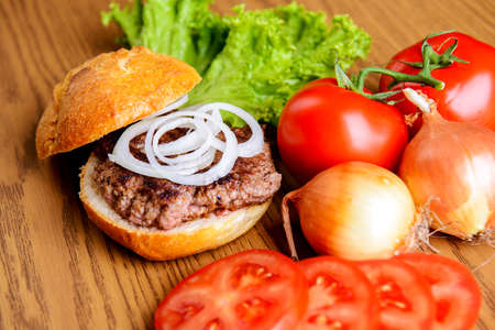 home made hamburger with meat, salad, onion, tomato