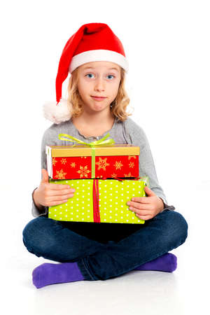 little funny girl with Santa- Claus cap looking amazed
