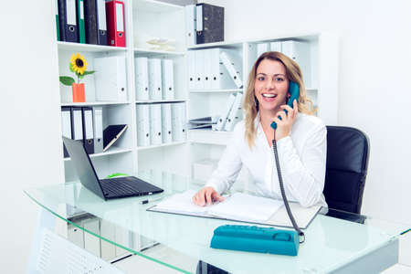 young blond businesswoman calling in the office