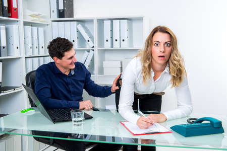sexual harassment in office- business man touch female colleague at buttocks Stock Photo