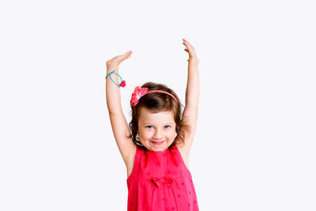 jubilating: happy girl with arms up in front of white background