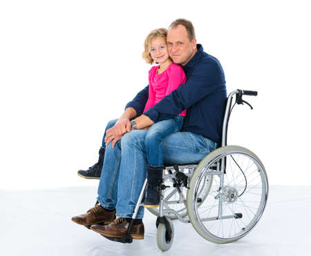 you disabled in wheelchair with his daughter in front of white background