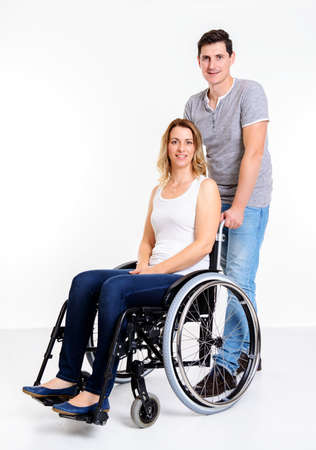 young disabled woman in wheelchair and her husband
