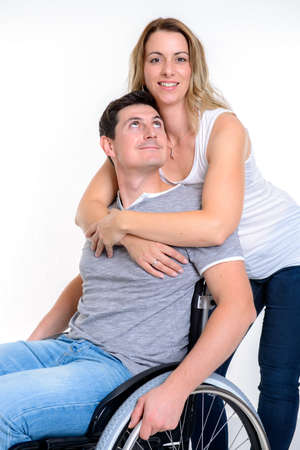 young disabled man in wheelchair and his wife Stock Photo