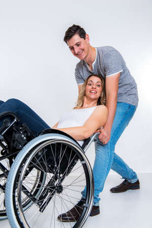 paraplegico: young disabled woman in wheelchair and her husband