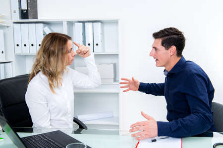 young business man and business woman in conflict  Stock Photo