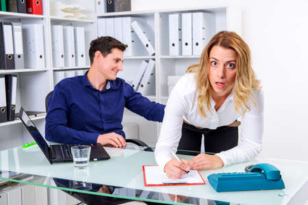 sexual harassment in office- business man touch female colleague at buttocks Stok Fotoğraf