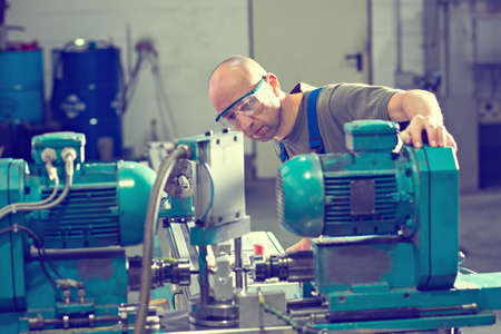 cutter: one worker in factory on the machine