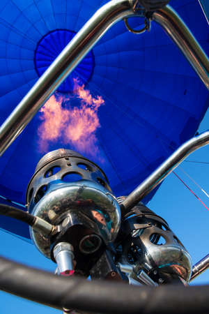 blower and inside of a blue hot- air balloon with flame Stock Photo