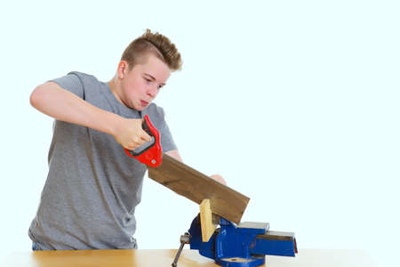 teenager in professional training using hand saw  in front of white background Stock Photo