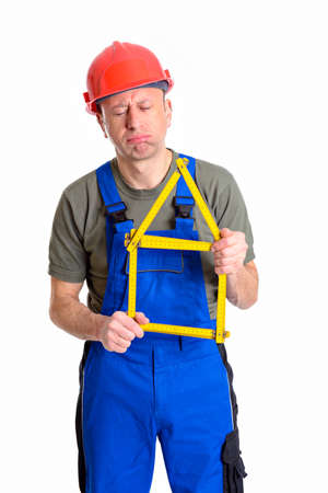 dissatisfied worker with yardstick- house in front of white background