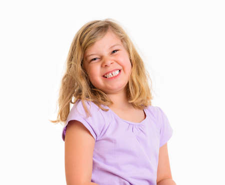 jubilating: happy girl smiling in front of white background
