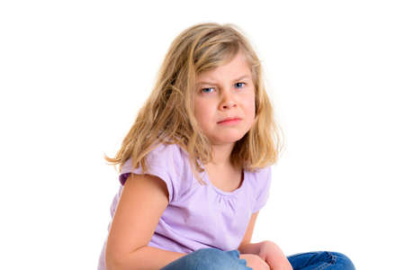 little girl in front of white background is in bad mood