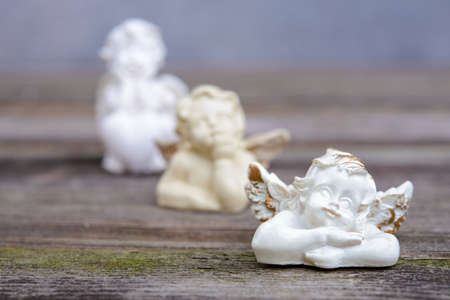 sill life with three angels on wooden ground Stock Photo