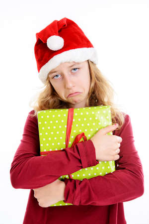 blond girl with Santa- cap is not happy with present
