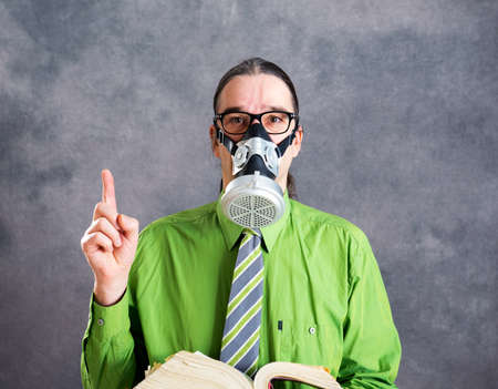 young business man in green shirt with gas mask and code of law
